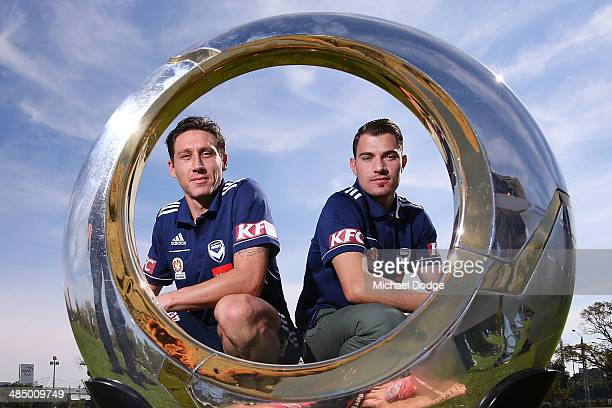Mark Milligan and James Troisi pose with the ALeague Trophy at Gosch's Paddock on April 16 2014 in Melbourne Australia The Victory start their finals...