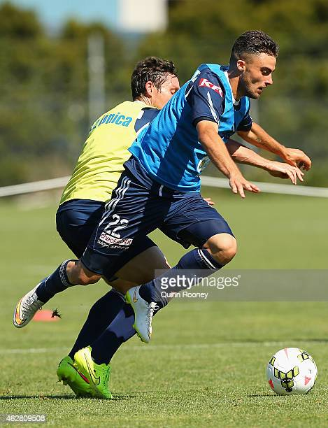Mark Milligan and Jesse Makarounas of the Victory contest for the ball during a Melbourne Victory ALeague training session at Gosch's Paddock on...