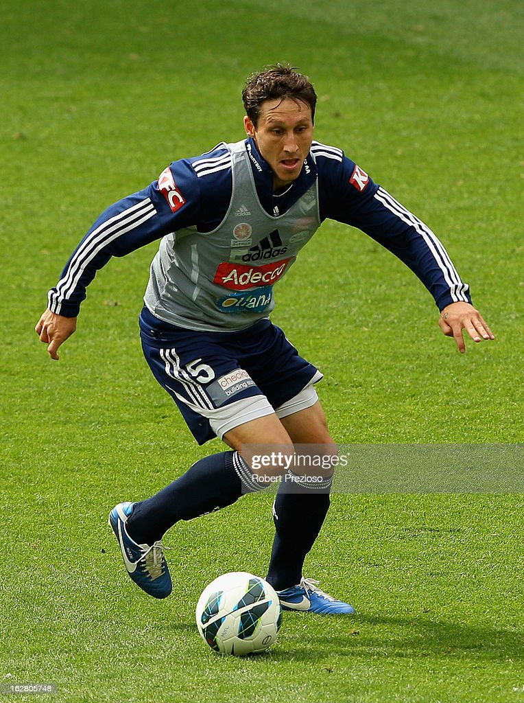 <a gi-track='captionPersonalityLinkClicked' href=/galleries/search?phrase=Mark+Milligan&family=editorial&specificpeople=557185 ng-click='$event.stopPropagation()'>Mark Milligan</a> controls the ball during a Melbourne Victory A-League training session at AAMI Park on February 28, 2013 in Melbourne, Australia.