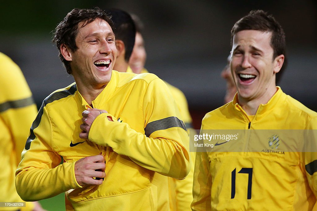 <a gi-track='captionPersonalityLinkClicked' href=/galleries/search?phrase=Mark+Milligan&family=editorial&specificpeople=557185 ng-click='$event.stopPropagation()'>Mark Milligan</a> (L) laughs with Matt McKay (R) during an Australian Socceroos training session at WIN Jubilee Stadium on June 13, 2013 in Sydney, Australia.