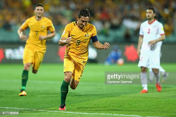 Mark Milligan of Australia celebrates kicking a penalty goal during the 2018 FIFA World Cup Qualification match between the Australia Socceroos and...