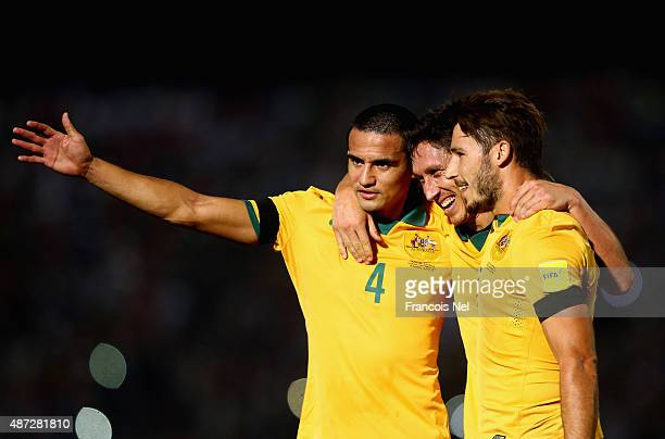 Mark Milligan of Australia celebrates with Mathew Leckie and Tim Chahill as he scores their first goal during the 2018 FIFA World Cup Qualifier match...