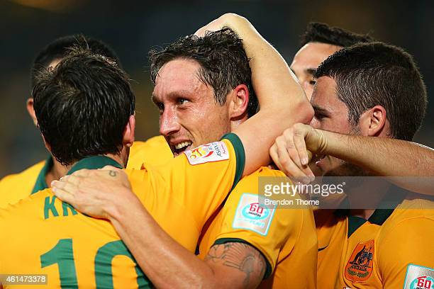 Mark Milligan of Australia celebrates with team mates after scoring a goal during the 2015 Asian Cup match between Oman and Australia at ANZ Stadium...