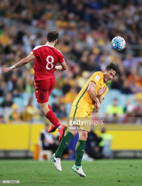 Mark Milligan of Australia competes for the ball against Mahmoud Al Mawas of Syria during the 2018 FIFA World Cup Asian Playoff match between the...