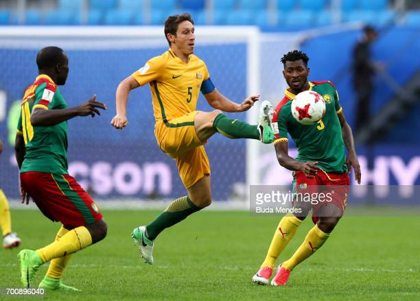 Mark Milligan of Australia goes past Andre Zambo of Cameroon during the FIFA Confederations Cup Russia 2017 Group B match between Cameroon and...