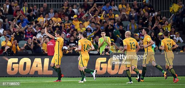 Mark Milligan of Australia reacts after scoring a goal during the 2018 FIFA World Cup Qualification match between the Australia Socceroos and...