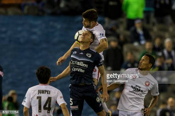 Mark Milligan of Melbourne Victory and Brendan Hamill of the Western Sydney Wanderers contest the ball during Round 5 of the Hyundai ALeague Series...