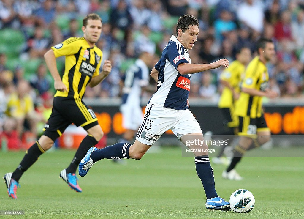 Mark Milligan of the Melbourne Victory runs with the ball during the round 15 A-League match between the Melbourne Victory and Wellington Phoenix at AAMI Park on January 5, 2013 in Melbourne, Australia.