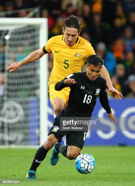 Mark Milligan of the Socceroos Chanathip Songkrasin of Thailand compete for the ball during the 2018 FIFA World Cup Qualifier match between the...