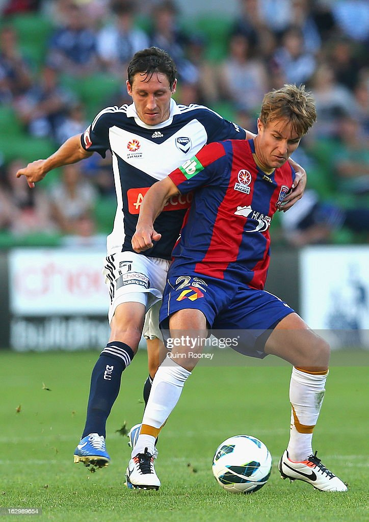 Mark Milligan of the Victory and Adam Taggart of the Jets contest for the ball during the round 23 A-League match between the Melbourne Victory and the Newcastle Jets at AAMI Park on March 3, 2013 in Melbourne, Australia.