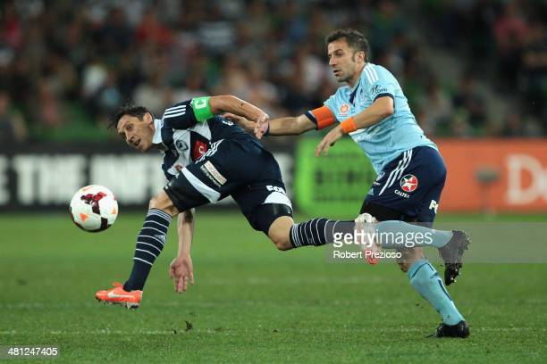 Mark Milligan of the Victory and Alessandro Del Piero of Sydney contest the ball during the round 25 ALeague match between Melbourne Victory and...