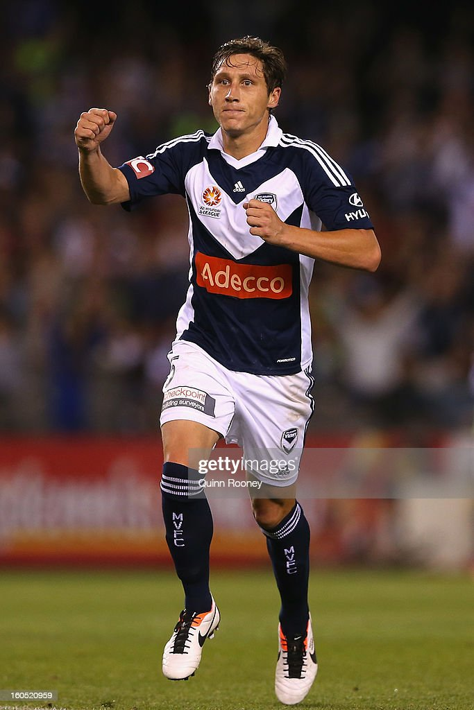<a gi-track='captionPersonalityLinkClicked' href=/galleries/search?phrase=Mark+Milligan&family=editorial&specificpeople=557185 ng-click='$event.stopPropagation()'>Mark Milligan</a> of the Victory celebrates scoring a goal during the round 19 A-League match between the Melbourne Victory and the Melbourne Heart at Etihad Stadium on February 2, 2013 in Melbourne, Australia.