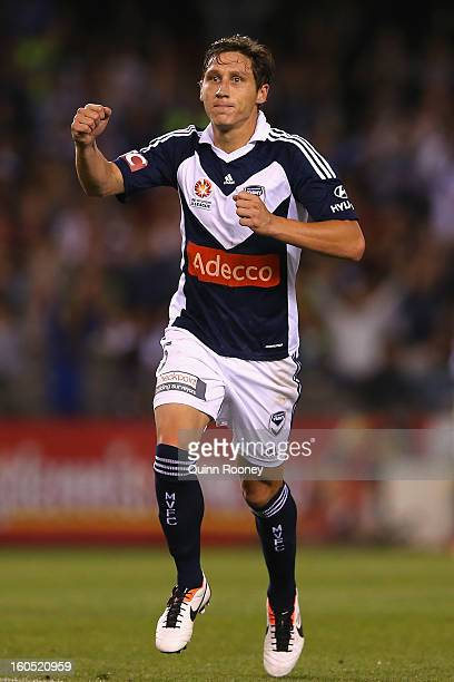 Mark Milligan of the Victory celebrates scoring a goal during the round 19 ALeague match between the Melbourne Victory and the Melbourne Heart at...