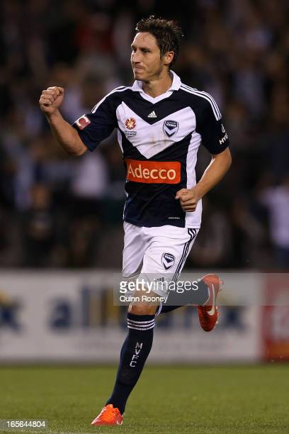 Mark Milligan of the Victory celebrates scoring a goal during the ALeague Elimination final match between Melbourne Victory and Perth Glory at Etihad...