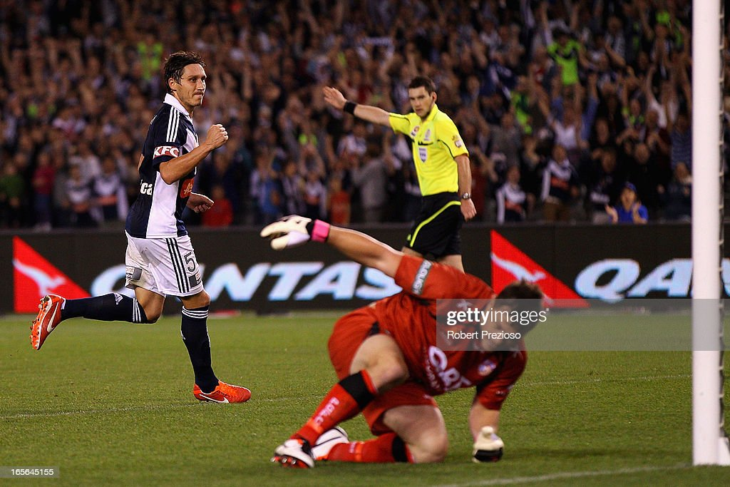 <a gi-track='captionPersonalityLinkClicked' href=/galleries/search?phrase=Mark+Milligan&family=editorial&specificpeople=557185 ng-click='$event.stopPropagation()'>Mark Milligan</a> of the Victory celebrates scoring a goal during the A-League Elimination final match between Melbourne Victory and Perth Glory at Etihad Stadium on April 5, 2013 in Melbourne, Australia.