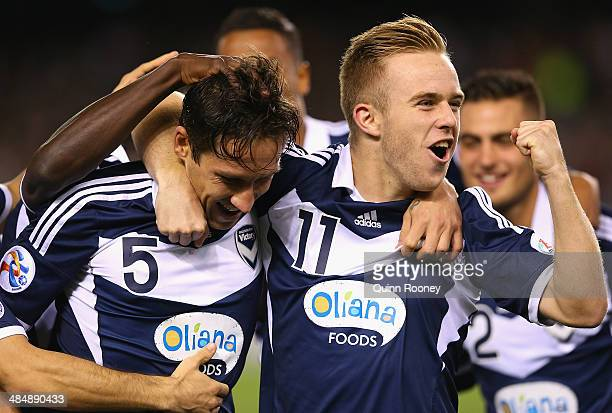 Mark Milligan of the Victory is congratulated by Connor Pain after scoring a goal during the AFC Asian Champions League match between the Melbourne...