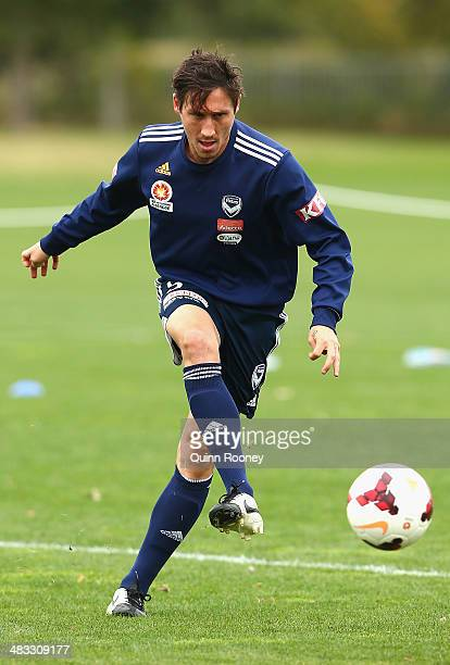 Mark Milligan of the Victory kicks during a Melbourne Victory ALeague training session at Gosch's Paddock on April 8 2014 in Melbourne Australia