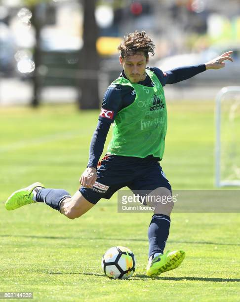 Mark Milligan of the Victory passes the ball during a Melbourne Victory ALeague training session at Gosch's Paddock on October 17 2017 in Melbourne...