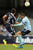 Mark Milligan of Victory and Terry Antonis of Sydney collide during the round 11 ALeague match between Melbourne Victory and Sydney FC at Etihad...