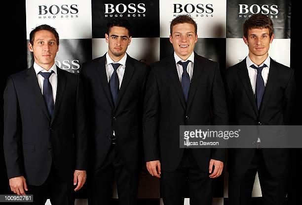 Mark MilliganRhys WilliamsShane Lowry and Dario Vidosic pose in their Hugo Boss suits the Official Formal Wear supplier to the Qantas Socceroos for...