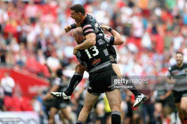 Mark Minichiello and Gareth Ellis celebrate after winning during Hull FC v Wigan Warriors in the Ladbrokes Challenge Cup at Wembley Stadium on August...