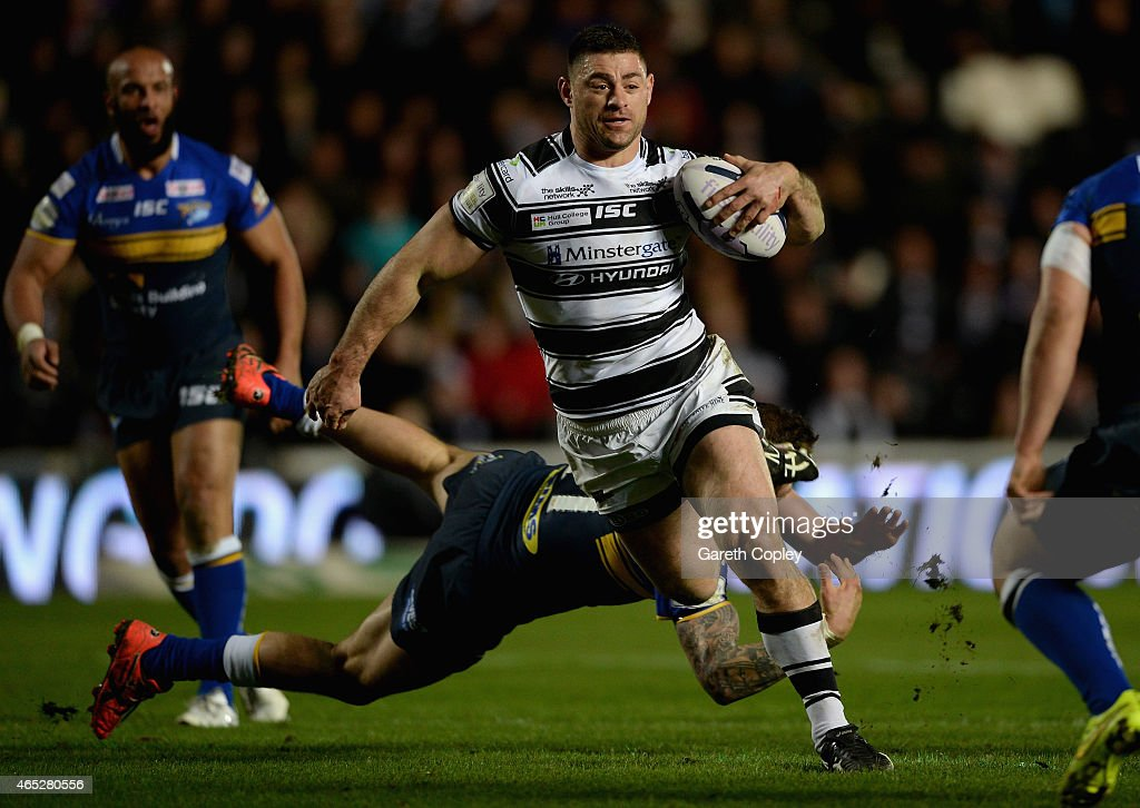 Mark Minichiello of Hull FC jumps from a tackle from Adam Cuthbertson of Leeds Rhinos during the First Utility Super League match between Hull FC and Leeds Rhinos at KC Stadium on March 5, 2015 in Hull, England.
