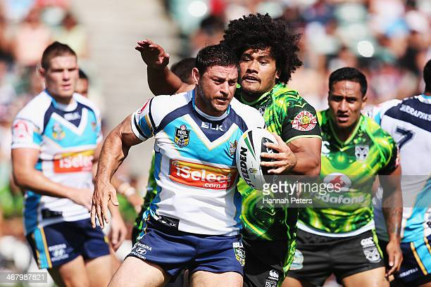 Mark Minichiello of the Titans makes a break during the NRL trial match between the New Zealand Warriors and the Gold Coast Titans at North harbour...