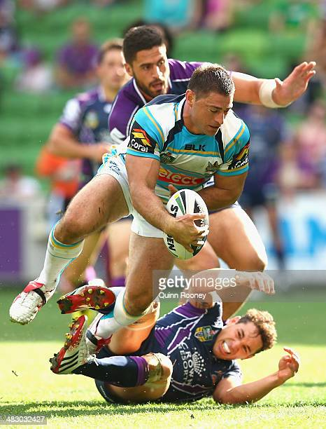 Mark Minichiello of the Titans scores a try over the top of Billy Slater of the Storm during the round five NRL match between the Melbourne Storm and...