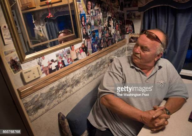 Mark Molnar age 62 looks at pictures of their kids and grandkids on the wall of their camper in Trenton ME on June 22 2017 He and his wife Joanne age...