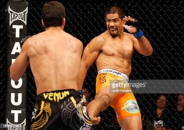 Mark Munoz kicks Lyoto Machida in their middleweight bout during the UFC Fight Night event at Phones 4 U Arena on October 26 2013 in Manchester...
