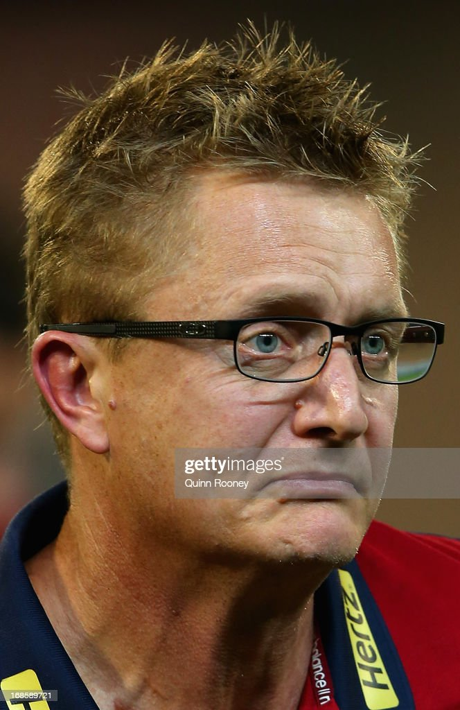 Mark Neeld the coach of the Demons leaves the field during the round seven AFL match between the Melbourne Demons and the Gold Coast Suns at Melbourne Cricket Ground on May 12, 2013 in Melbourne, Australia.