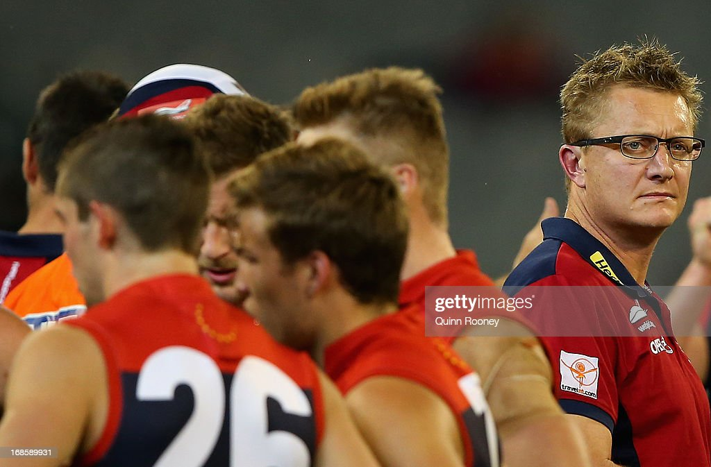 Mark Neeld the coach of the Demons looks on during the round seven AFL match between the Melbourne Demons and the Gold Coast Suns at Melbourne Cricket Ground on May 12, 2013 in Melbourne, Australia.