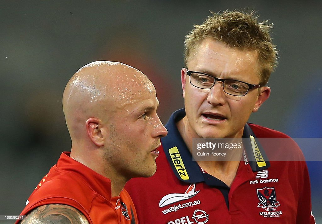 Mark Neeld the coach of the Demons talks to Nathan Jones of the Demons during the round seven AFL match between the Melbourne Demons and the Gold Coast Suns at Melbourne Cricket Ground on May 12, 2013 in Melbourne, Australia.
