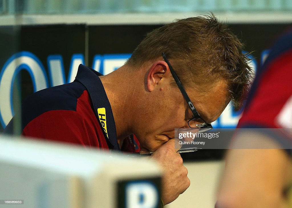 Mark Neeld the coach of the Demons thinks as he sits on the bench during the round seven AFL match between the Melbourne Demons and the Gold Coast Suns at Melbourne Cricket Ground on May 12, 2013 in Melbourne, Australia.