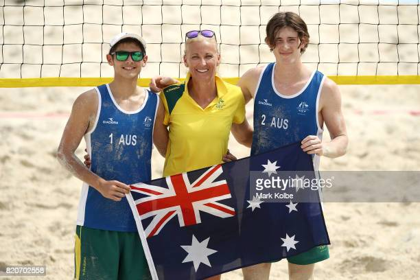 Mark Nicolaidis coach Kerri Pottharst and James Takken of Australia pose after victory in the boy's beach volleyball bronz emedal final match on day...