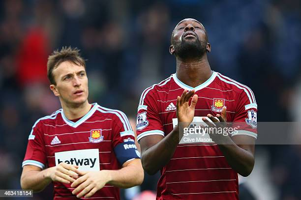 Mark Noble and Carlton Cole of West Ham United react after defeat during the FA Cup Fifth Round match between West Bromwich Albion and West Ham...