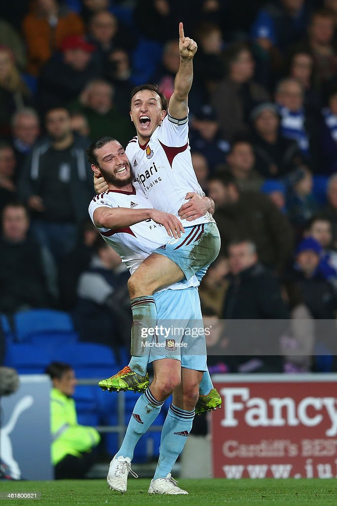 <a gi-track='captionPersonalityLinkClicked' href=/galleries/search?phrase=Mark+Noble&family=editorial&specificpeople=844055 ng-click='$event.stopPropagation()'>Mark Noble</a> (R) celebrates with <a gi-track='captionPersonalityLinkClicked' href=/galleries/search?phrase=Andy+Carroll+-+Soccer+Player&family=editorial&specificpeople=1449090 ng-click='$event.stopPropagation()'>Andy Carroll</a> (L) of West Ham United after scoring his sides second goal duering the Barclays Premier League match between Cardiff City and West Ham United at the Cardiff City Stadium on January 11, 2014 in Cardiff, Wales.