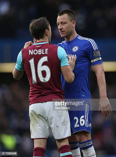 Mark Noble of West Ham and John Terry of Chelsea during the Barclays Premier League match between Chelsea and West Ham at Stamford Bridge on March 19...