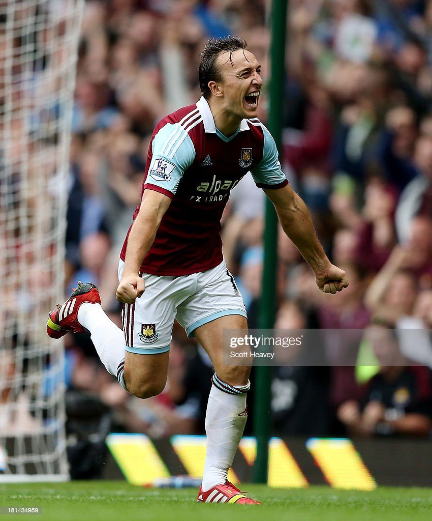 <a gi-track='captionPersonalityLinkClicked' href=/galleries/search?phrase=Mark+Noble&family=editorial&specificpeople=844055 ng-click='$event.stopPropagation()'>Mark Noble</a> of West Ham celebrates after scoring their second goal during the Barclays Premier League match between West Ham United and Everton at the Boleyn Ground on September 21, 2013 in London, England.