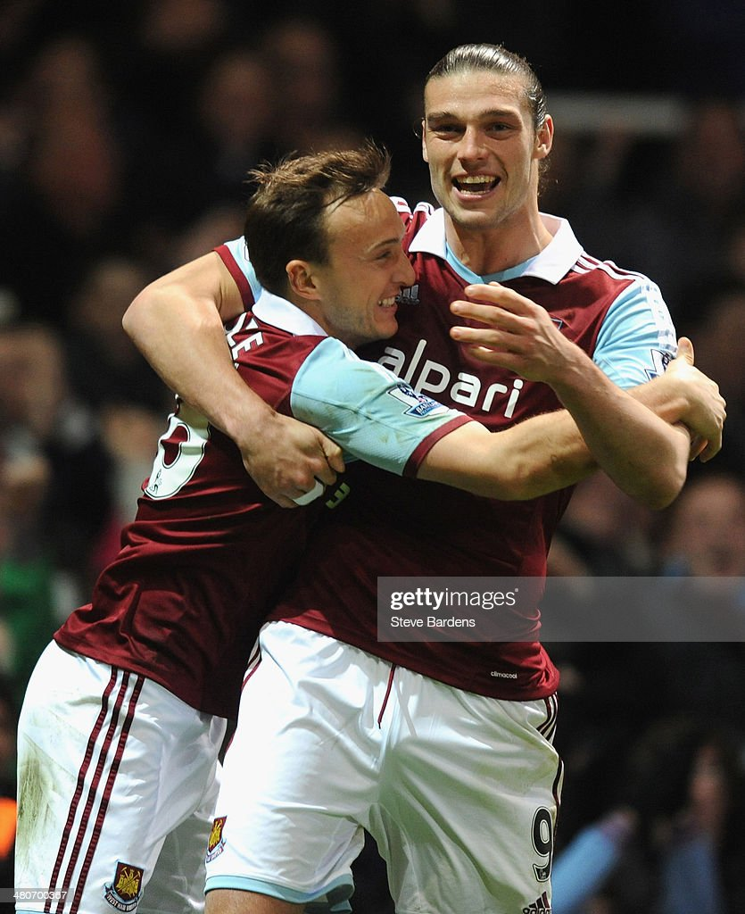 <a gi-track='captionPersonalityLinkClicked' href=/galleries/search?phrase=Mark+Noble&family=editorial&specificpeople=844055 ng-click='$event.stopPropagation()'>Mark Noble</a> of West Ham celebrates scoring the opening goal from the penalty spot with <a gi-track='captionPersonalityLinkClicked' href=/galleries/search?phrase=Andy+Carroll+-+Soccer+Player&family=editorial&specificpeople=1449090 ng-click='$event.stopPropagation()'>Andy Carroll</a> of West Ham during the Barclays Premier League match between West Ham United and Hull City at Boleyn Ground on March 26, 2014 in London, England.