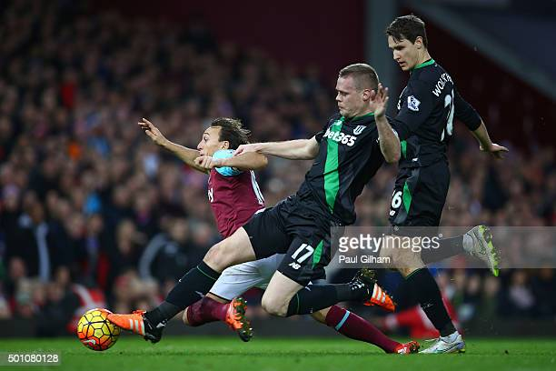 Mark Noble of West Ham United annd Ryan Shawcross of Stoke City compete for the ball in the penalty area during the Barclays Premier League match...