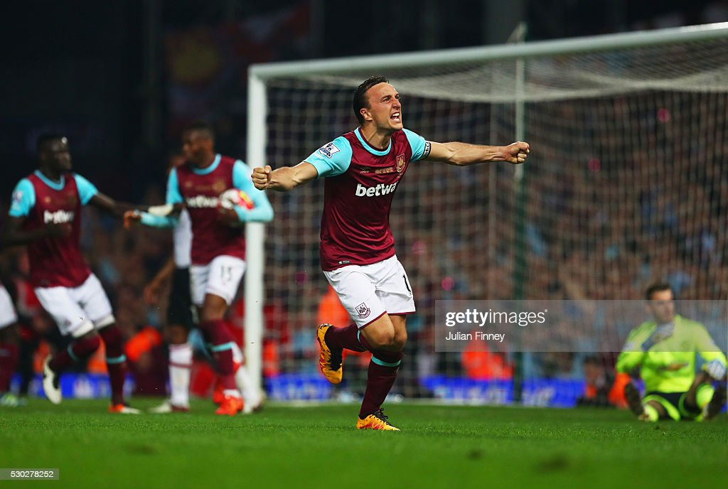 <a gi-track='captionPersonalityLinkClicked' href=/galleries/search?phrase=Mark+Noble&family=editorial&specificpeople=844055 ng-click='$event.stopPropagation()'>Mark Noble</a> of West Ham United celebrates as <a gi-track='captionPersonalityLinkClicked' href=/galleries/search?phrase=Michail+Antonio&family=editorial&specificpeople=5806303 ng-click='$event.stopPropagation()'>Michail Antonio</a> of West Ham United scores their second and equalising goal during the Barclays Premier League match between West Ham United and Manchester United at the Boleyn Ground on May 10, 2016 in London, England. West Ham United are playing their last ever home match at the Boleyn Ground after their 112 year stay at the stadium. The Hammers will move to the Olympic Stadium for the 2016-17 season.