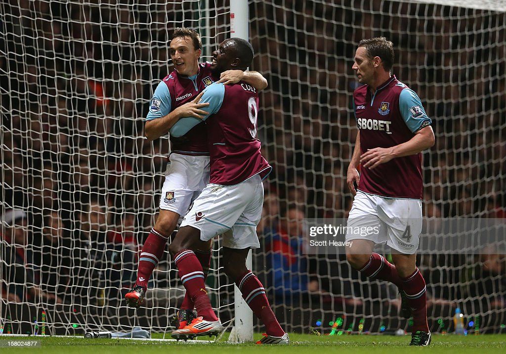 Mark Noble (L) of West Ham United celebrates his penalty with Carlton Cole during the Barclays Premier League match between West Ham United and Liverpool at the Boleyn Ground on December 9, 2012 in London, England.