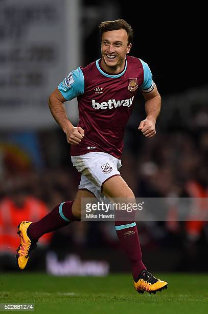 Mark Noble of West Ham United celebrates scoring his second goal during the Barclays Premier League match between West Ham United and Watford at the...