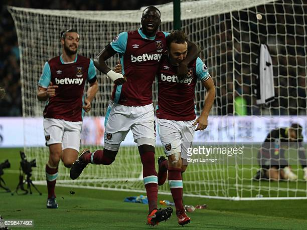 Mark Noble of West Ham United celebrates scoring his sides first goal with Cheikhou Kouyate of West Ham United during the Premier League match...
