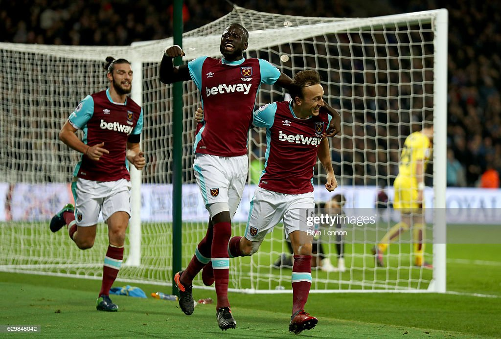 Mark Noble of West Ham United (R) celebrates scoring his sides first goal with Cheikhou Kouyate of West Ham United (C) during the Premier League match between West Ham United and Burnley at London Stadium on December 14, 2016 in Stratford, England.