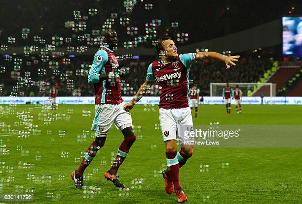 Mark Noble of West Ham United celebrates scoring his sides first goal during the Premier League match between West Ham United and Hull City at London...