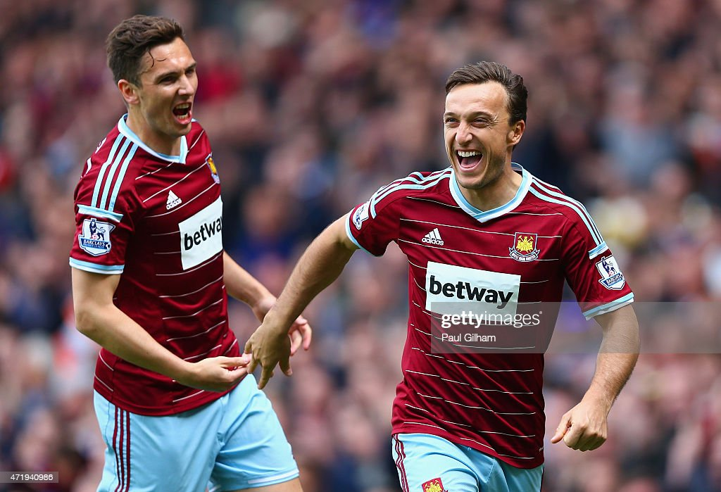 <a gi-track='captionPersonalityLinkClicked' href=/galleries/search?phrase=Mark+Noble&family=editorial&specificpeople=844055 ng-click='$event.stopPropagation()'>Mark Noble</a> of West Ham United celebrates scoring his team's first goal from the penalty spot with his team mate <a gi-track='captionPersonalityLinkClicked' href=/galleries/search?phrase=Stewart+Downing&family=editorial&specificpeople=238961 ng-click='$event.stopPropagation()'>Stewart Downing</a> during the Barclays Premier League match between West Ham United and Burnley at the Boleyn Ground on May 2, 2015 in London, England.