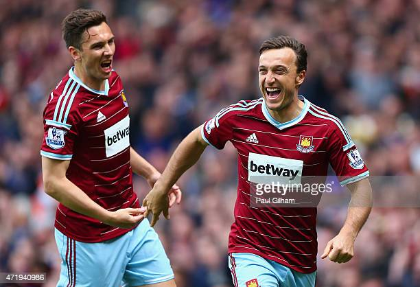 Mark Noble of West Ham United celebrates scoring his team's first goal from the penalty spot with his team mate Stewart Downing during the Barclays...