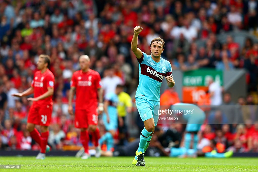 <a gi-track='captionPersonalityLinkClicked' href=/galleries/search?phrase=Mark+Noble&family=editorial&specificpeople=844055 ng-click='$event.stopPropagation()'>Mark Noble</a> of West Ham United celebrates scoring his team's second goal from the penalty spot during the Barclays Premier League match between Liverpool and West Ham United at Anfield on August 29, 2015 in Liverpool, England.
